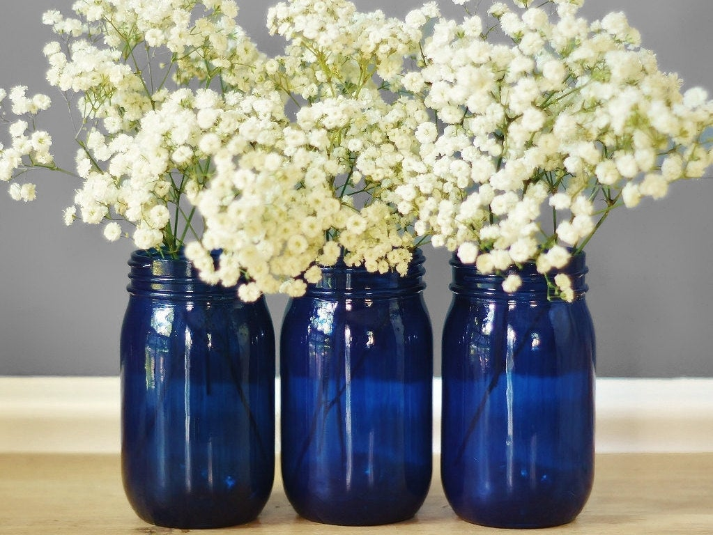 Blue mason jars used as vases