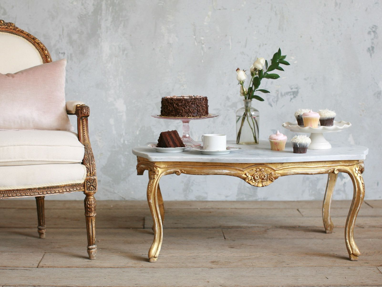 Vintage coffee tables arranged with cupcakes