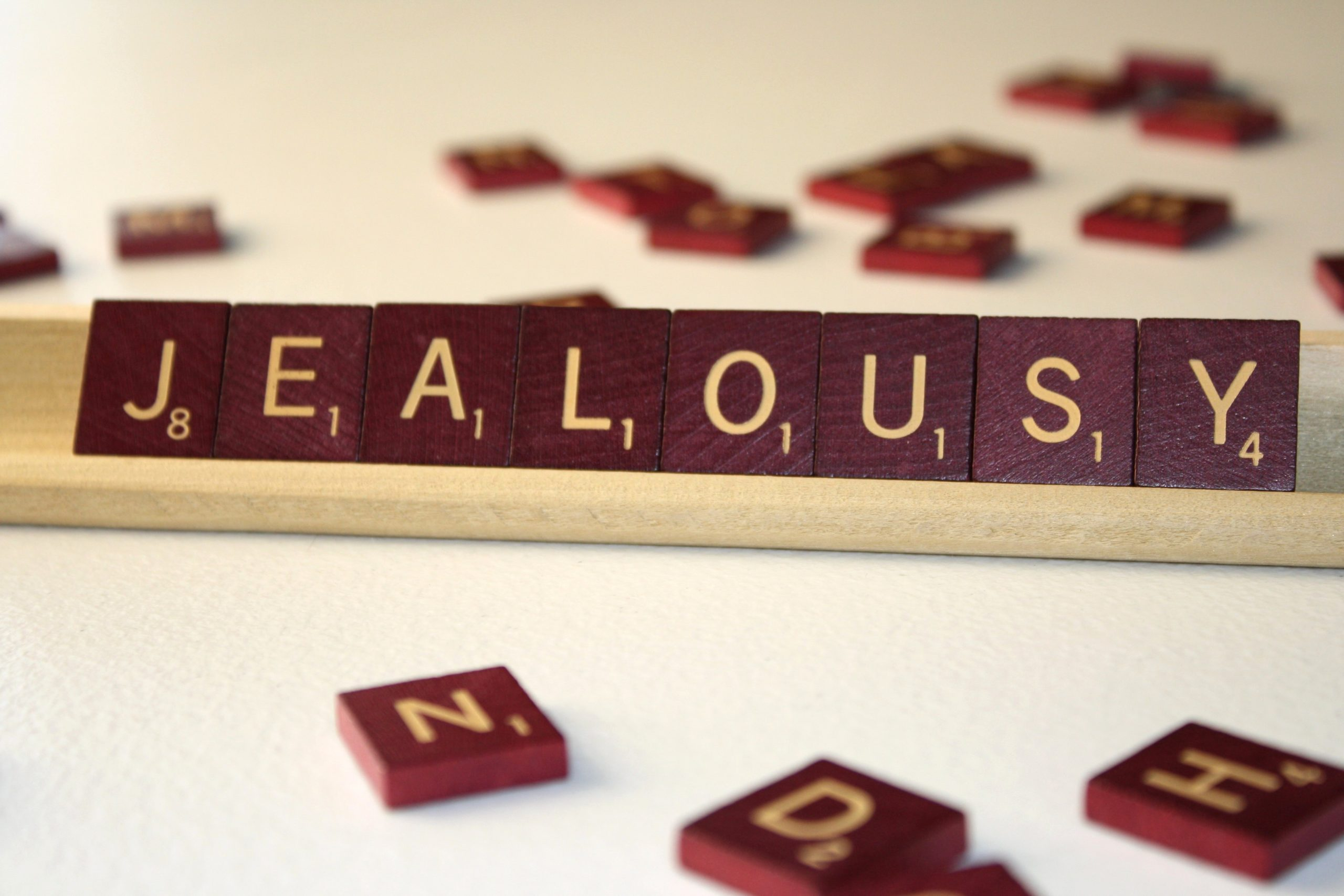 The word jealousy written using Scrabble blocks