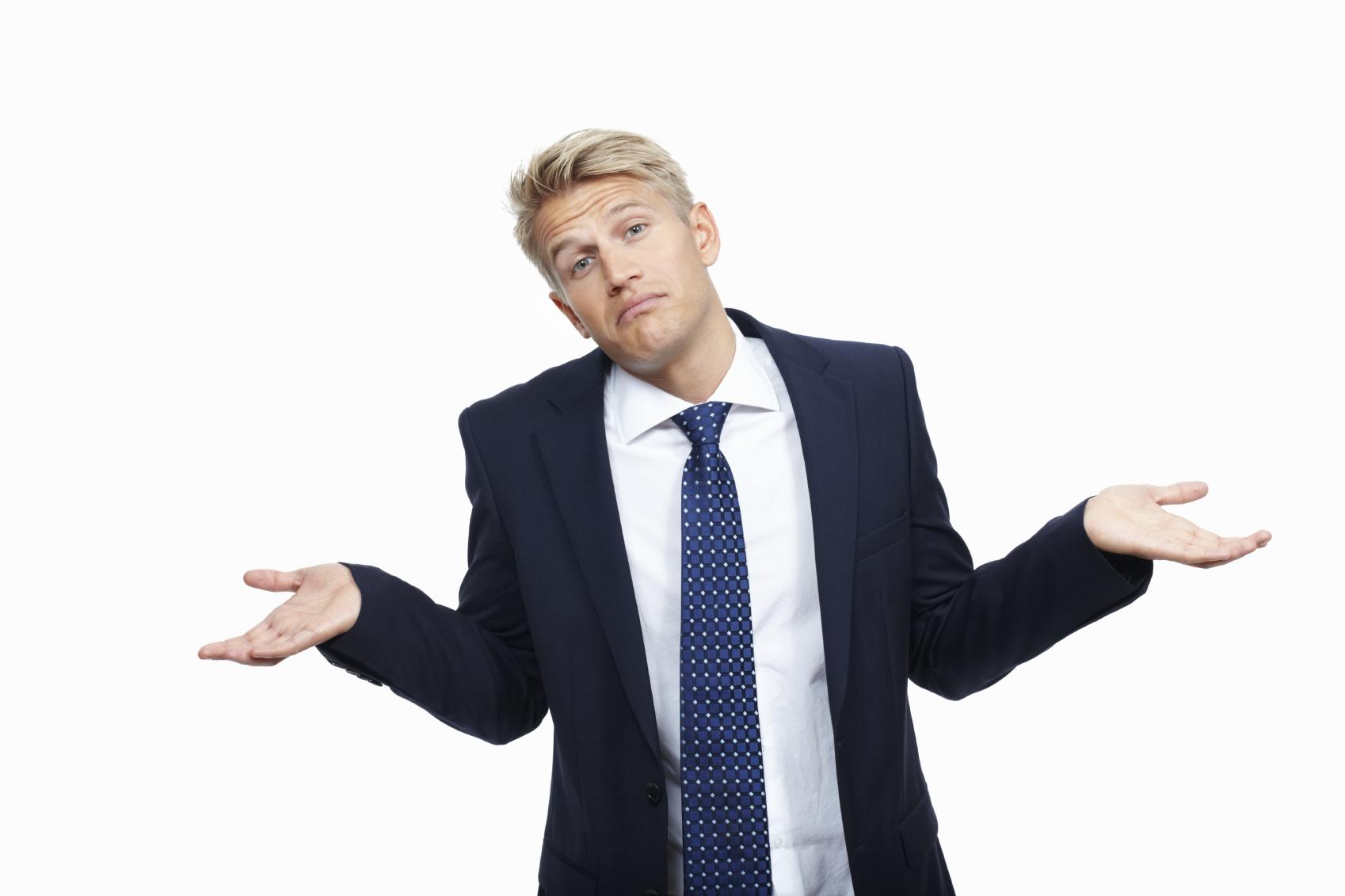 Portrait of clueless husband man shrugging on white background