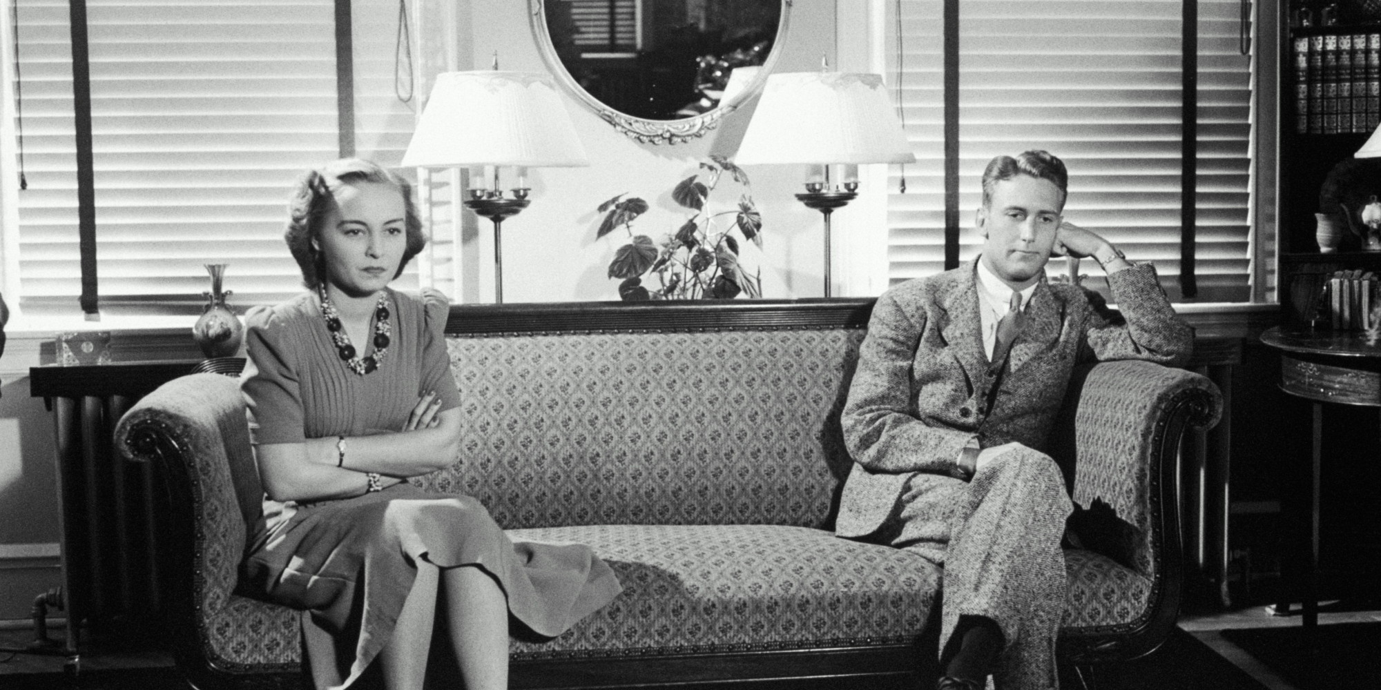 Vintage photo of a married couple sitting in distance