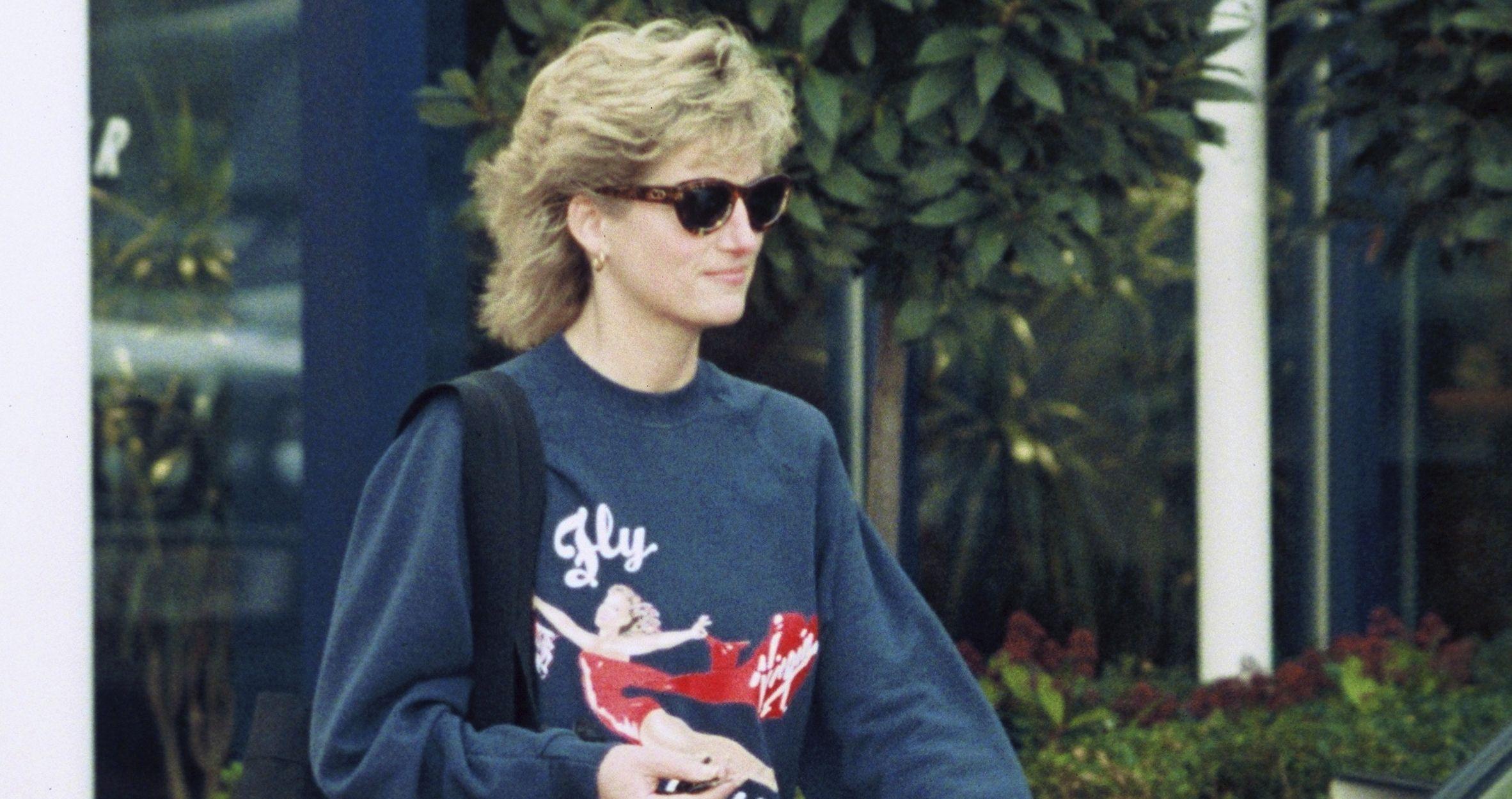 Princess Diana wearing a blue sweater