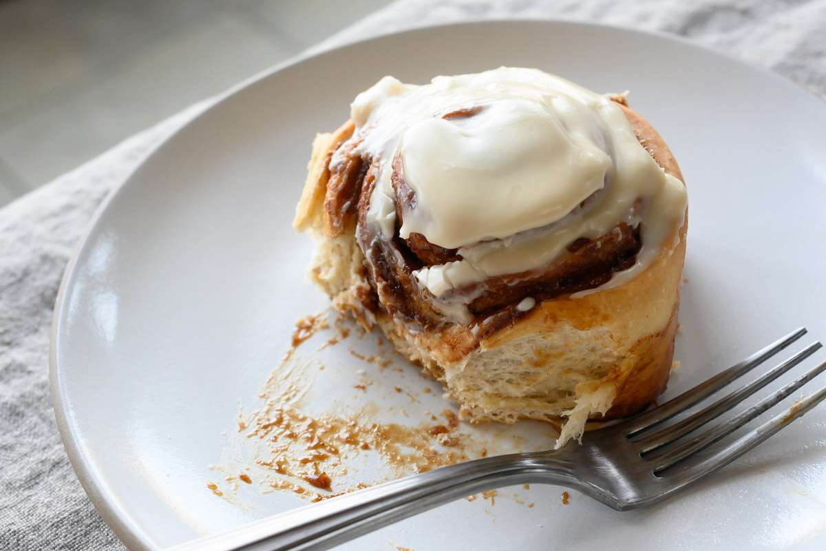 A serving presentation of a cinnamon roll