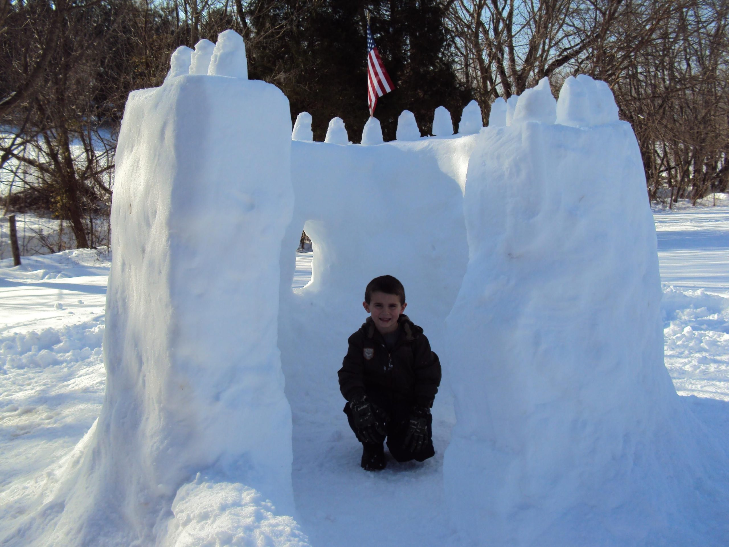 Kid inside a snow fort