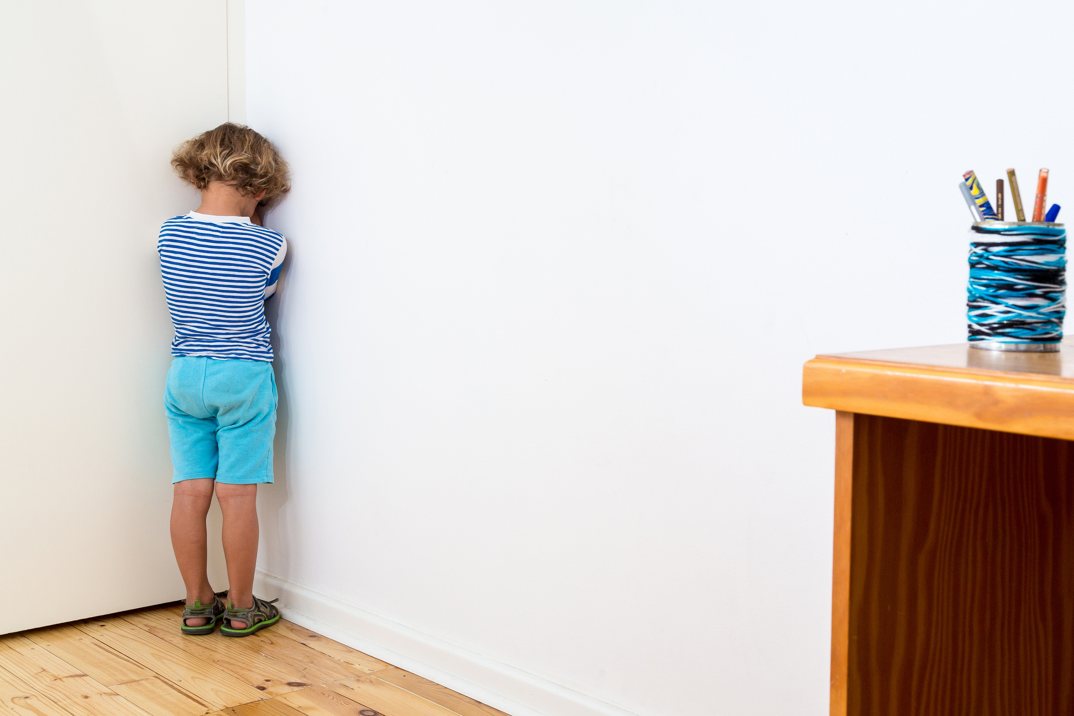Child in naughty corner, being bullied, having time out or having a tantrum.