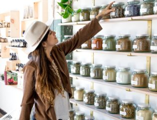 Adriana Ayales, the founder and owner of Anima Mundi Apothecary, picking ingredients for her products.